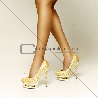 sexy legs and gold girl shoes