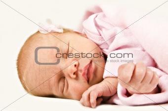 New born baby girl sleeping peacefully