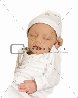 New born baby sleeping peacefully - dressed in white