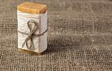 natural soap with linen ribbon on the natural rough fabric