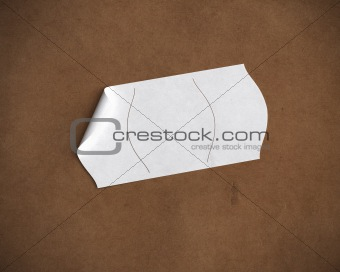 blank price tag over recycled paper