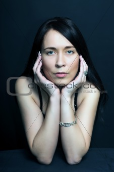 portrait brunette  woman on black background