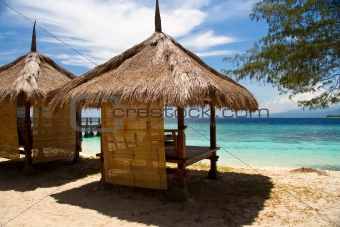 Hut at beach and turquoise sea on island, Gili Islands