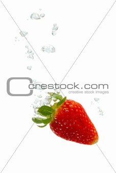 Strawberry in water with air bubbles