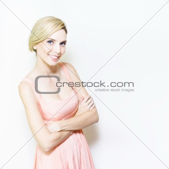 Beautiful, smiling woman in pink dress