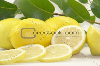 Fresh juicy lemons with leaves