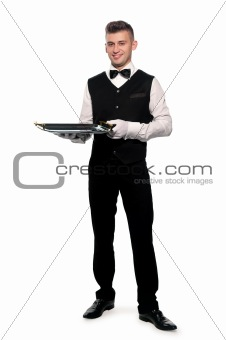 A young boy waiter with a tray