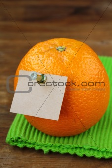 one ripe fresh oranges on a wooden background