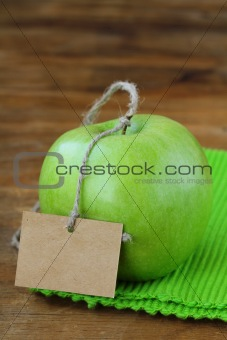 green fresh apples on a wooden background