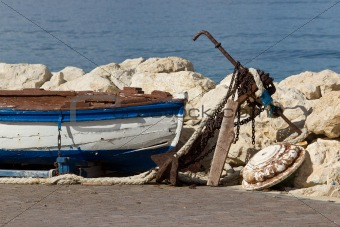 Old wooden boat and rusty anchor