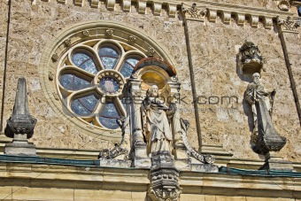 Church architectural detail - window and saint statue
