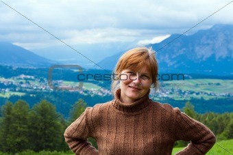 Alps summer village and woman portrait