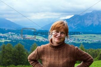 Alps summer village and woman portrait