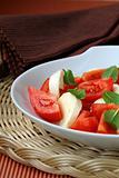Traditional Italian Caprese salad mozzarella with tomatoes and basil