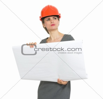 Authoritative architect woman with flipchart looking into distance