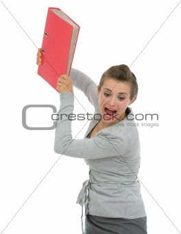 Angry business woman throwing folder in rage