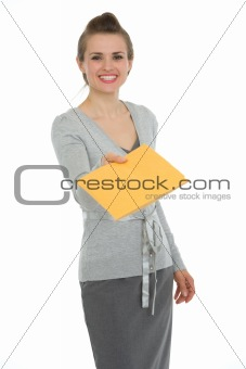 Happy woman giving letter