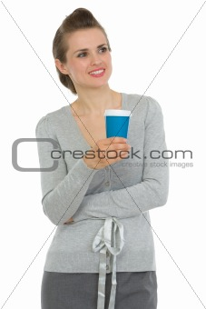 Smiling business woman with cup of coffee looking on copy space