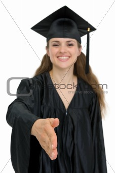 Graduation girl stretching hand for handshake. Focus on hand
