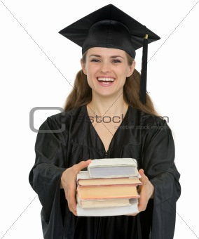 Graduation girl student giving stack of books