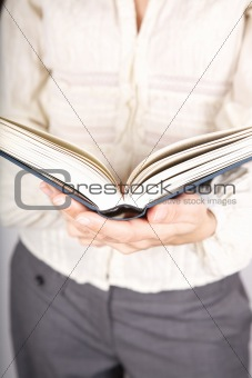 book and businesswoman