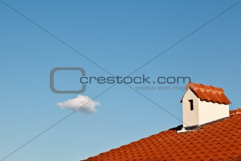 Beautiful Cloud and Dormer Window with Red Tiled Roof