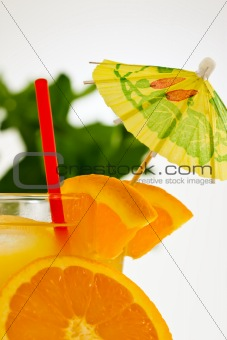refreshing orange drink with a straw and umbrella