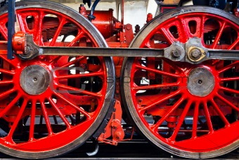 Two large red wheels of the old steam locomotive