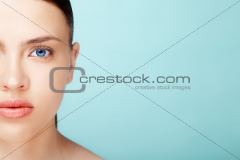 Fresh clear healthy skin on the face of beautiful woman over blu
