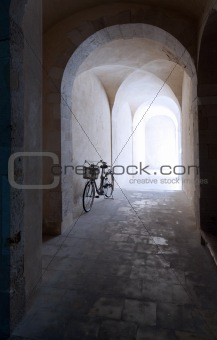 old arcade and bicycle