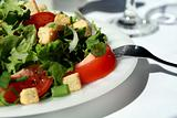 Healthy green salad with tomatoes and croutons