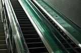 detail of modern glass and metal escalator