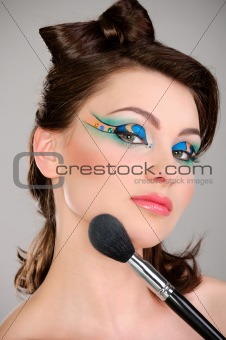 Beautiful girl makes a makeup