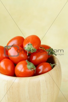 small cherry tomatoes in a wooden bowl