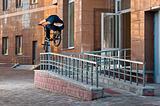 Biker doing rail hop trick back view
