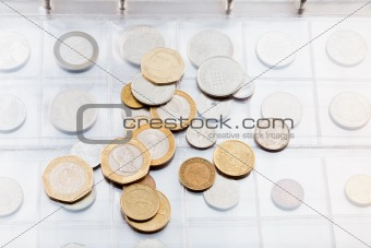 numismatics album with different coins