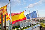Catalan, Spanish, EU flags under Barcelona