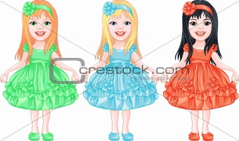 set of charming little girls in fancy dresses