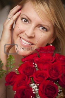 Beautiful Smiling Blonde Woman with Red Roses.