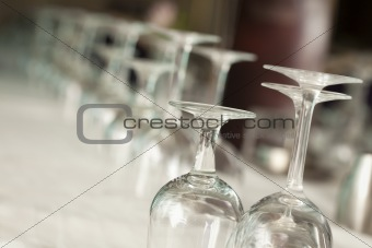 Several Drinking Glasses Abstract in Formal Dining Room Setting.
