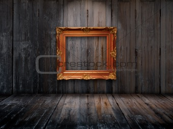 Old picture frame on wooden wall