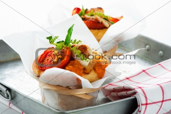 Fresh pizza muffin as a snack on white background as a studio sh