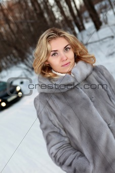 Young woman near the car