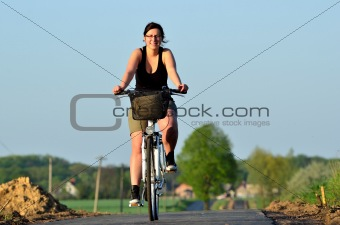 Young woman riding a new bicycle path