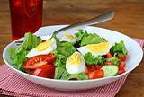 salad with eggs and  fresh vegetables,  on a plate