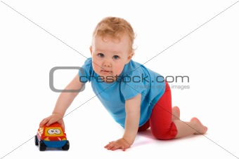 Portrait of baby with toy car