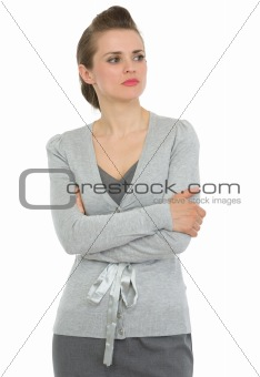 Business woman with crossed arms looking on copy space