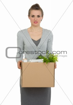 Woman employee holding box with personal items