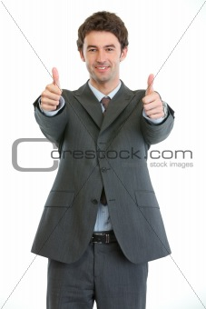 Modern businessman showing thumbs up