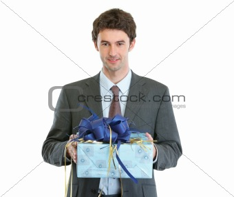Modern businessman with present in hands